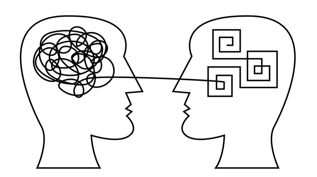 Line drawing of information exchange between two human heads.