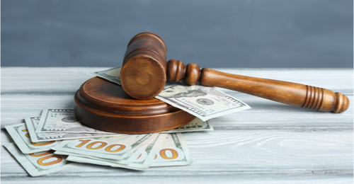 Image of a gavel and money representing economic and law concept.