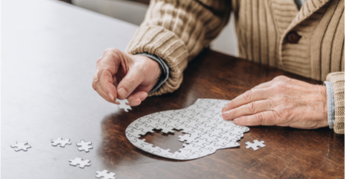 Man putting together a puzzle.