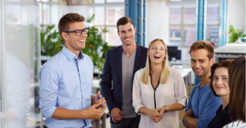Image of a team laughing and working together.